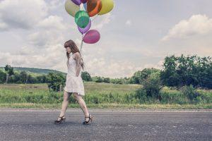 The How not to worry - woman with balloons - Worry Trap Blog - Generation Women