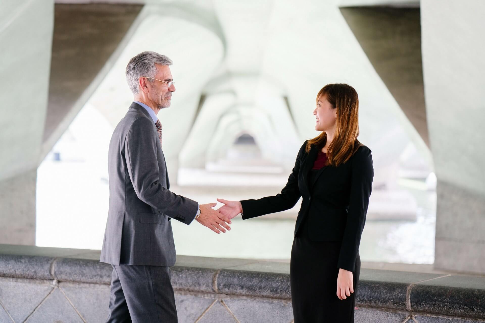 Gender Equality Myths - woman and man shaking hands