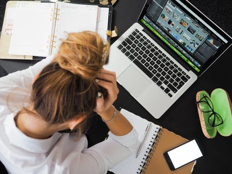 Woman with laptop hates job - why are women leaving your company
